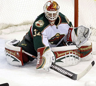 Goalie Niklas Backstrom stops 34 shots to prevent the Wild from starting 0-9 on the road.  (AP)
