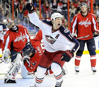 R.J. Umberger celebrates the winner as Caps goalie Jose Theodore obviously is bummed.  (Getty Images)