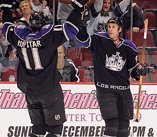 Ryan Smyth (right) celebrates one of his two goals to help the Kings rally past the Coyotes.  (Getty Images)