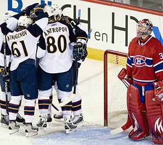 The Thrashers celebrate the winning goal, beating goalie Carey Price in the third period.  (AP)