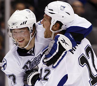 Tampa Bay's Ryan Malone (right) celebrates with Victor Hedman after his winning goal in overtime.   (AP)