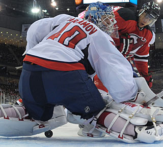 Niclas Bergfors gets enough of the puck to tip it past goalie Semyon Varlamov. (Getty Images)