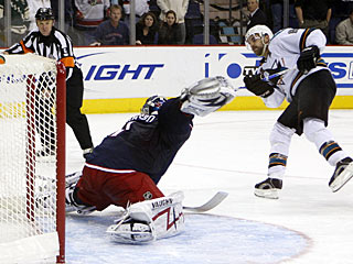 Dan Boyle goes wide right to beat goalie Steve Mason for the only goal in the shootout. (AP)