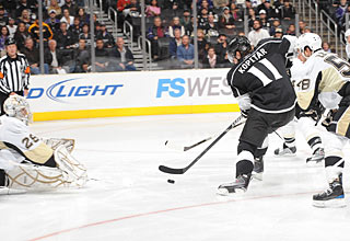 Anze Kopitar scores one of his two goals, and ends the game with a league-leading 26 points.  (Getty Images)