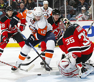 Yann Danis, who won 10 games for the Isles last season, stops 23 against his ex-mates. (Getty Images)
