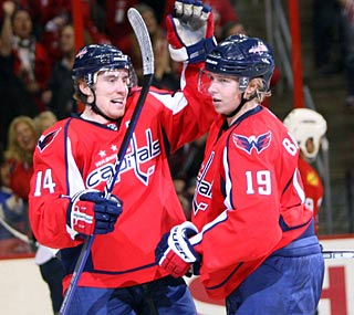 Tomas Fleischmann (left) scores twice in the Capitals' five-goal outburst in the third.  (Getty Images)