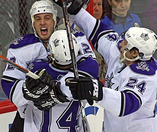 Randy Jones (12) gets a stylish debut with the Kings, scoring one goal and setting one up. (AP)