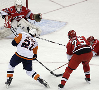 Kyle Okposo takes advantage of a turnover and snaps a very late winner for the Islanders. (AP)