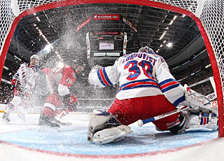 Henrik Lundqvist stops 35 shots in regulation and five players in the shootout. (Getty Images)