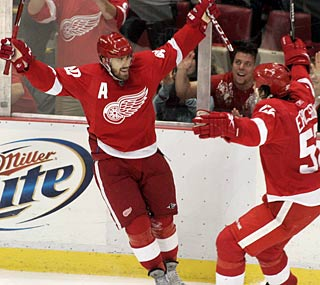 Henrik Zetterberg (left) has five points as the Wings top the Ducks in a rematch of their playoff series.    (AP)