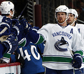 Henrik Sedin puts his name on the scoring sheet with three goals for the first time in his NHL career. (AP)