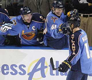 Ilya Kovalchuk and Maxim Afinogenov are happy after Slava Kozlov scores his goal of the season. (AP)