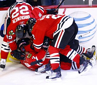 It's a pile-up celebration on Brent Seabrook, who tallies the winner 41 seconds into OT. (US Presswire)