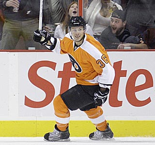 Darroll Powe shares the joy with Flyers fans after opening the scoring in the first period.  (AP)