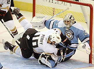 Corey Porey can't rattle Penguins goaltender Marc-Andre Fleury, who stops 23 of 25 shots.  (US Presswire)