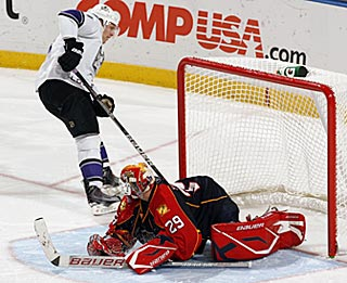 After scoring on a power play early, Jack Johnson beats Tomas Vokoun in the shootout.  (Getty Images)