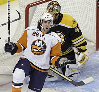 Matt Moulson whoops it up after scoring against Boston's Tuukka Rask in the first period.  (AP)
