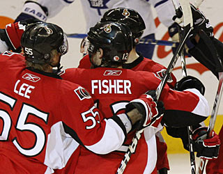 Mike Fisher is a popular teammate after his second goal -- the Senators' go-ahead score. (AP)
