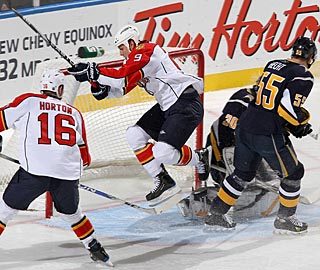 Stephen Weiss (9) is one of the scorers for the Panthers, who pressure Ryan Miller. (Getty Images)