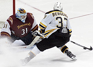 Patrice Bergeron gets the game winner by Thrashers goalie Ondrej Pavelec in the shootout. (AP)
