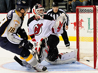 Mike Santorelli is one of two Predators to put the puck past Martin Brodeur in the shootout. (AP)