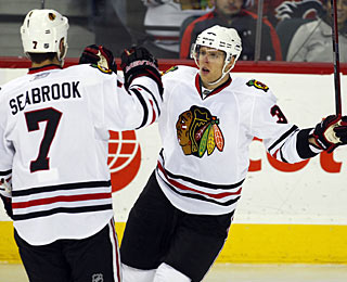 Kris Versteeg (right) celebrates the first of his two power-play goals with Brent Seabrook. (AP)
