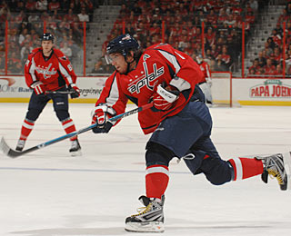 Alexander Ovechkin takes one of his five shots, but the Caps cannot complete the rally. (Getty Images)