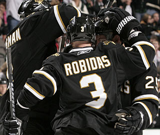 Defenseman Stephane Robidas celebrates one of his goals with teammates. (Getty Images)