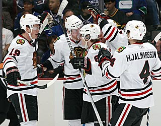 The Blackhawks celebrate a rare goal by Bryan Bickell (rear) early in the third period.  (Getty Images)