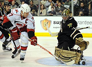 Marty Turco denies Carolina's Rod Brind'Amour on this quality scoring chance.  (Getty Images)