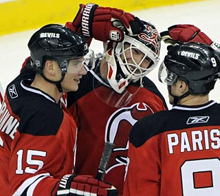 Jamie Langenbrunner, Martin Brodeur and Zach Parise are relieved to be back in the win column.  (AP)