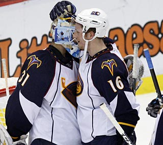 The Thrashers' Ondrej Pavelec is congratulated after earning his second shutout of the season.  (AP)