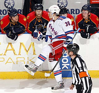 The Panthers' enthusiasm wanes after watching the Rangers' P.A. Parenteau score in the shootout.  (AP)