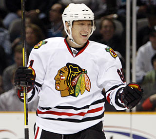 Marian Hossa makes a great first impression with his new team four months after shoulder surgery.  (AP)