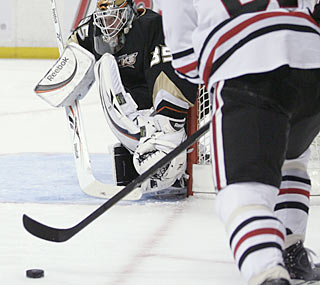 Ducks goalie Jean-Sebastien Giguere makes 28 saves at the net for his 32nd career shutout. (AP)
