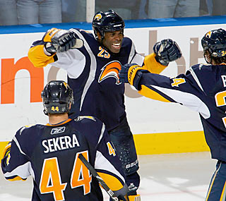 Mike Grier (25) is the first of five different Sabres to score a goal on Carolina in the third.  (Getty Images)