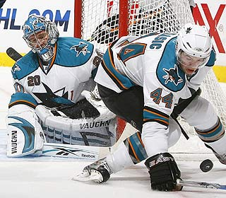 Evgeni Nabokov leans on his defense a bit, but stands tough in net and finishes with 28 saves. (Getty Images)