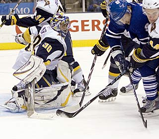 Ryan Miller makes one of his 38 stops to beat the Maple Leafs for the second time this season.  (AP)