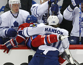 Christian Hanson gives the Canadiens' Josh Gorges an up close and personal view of the Leafs' bench.  (AP)