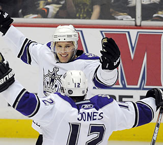 Jack Johnson celebrates with Kings teammate Randy Jones moments after Johnson's go-ahead goal.  (AP)