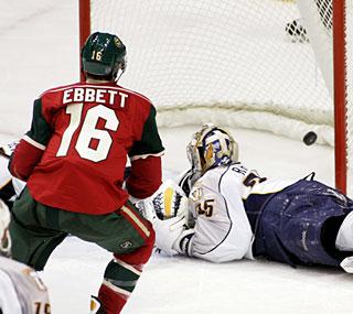 Andrew Ebbett beats Nashville goalie Pekka Rinne in overtime to give Minnesota the win.  (AP)