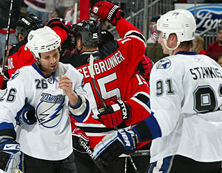 While Jamie Langenbrunner celebrates his goal, Martin St. Louis and Steven Stamkos skate off dejected. (AP)