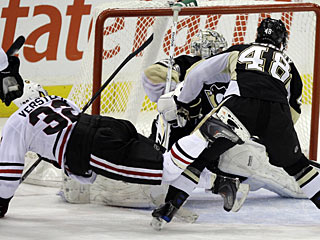 Kris Versteeg falls to the ice after scoring the winner on Marc-Andre Fleury. (AP)