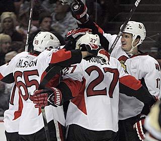 The Senators celebrate Filip Kuba's third-period goal as Ottawa ends a four-game skid.  (AP)