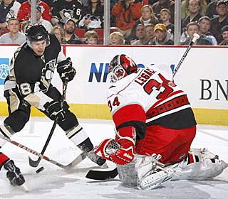 Manny Legace makes life rough for the Pens, stopping 30 shots in the Canes' first road win.  (AP)