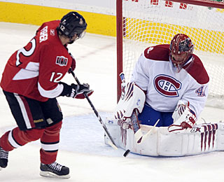 Jaroslav Halak denies Mike Fisher a point blank-scoring chance and finishes with 45 saves.  (AP)