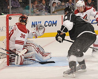 Oscar Moller finds some space high over Ilya Bryzgalov to score his first goal for the Kings. (Getty Images)