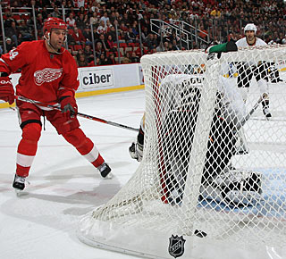 Todd Bertuzzi smacks a shot off Jean-Sebastien Giguere's skate to tie the game. (Getty Images)