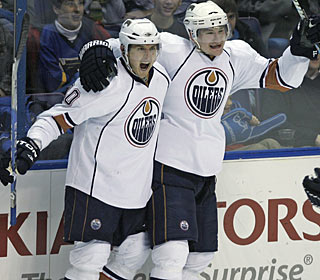 Shawn Horcoff celebrates with Ladislav Smid what turns out to be the winning goal in the third. (AP)