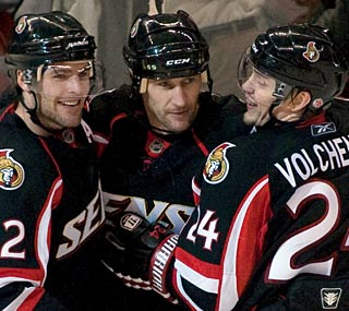 Alexei Kovalev (middle) has a memorable night with three goals, including the 400th of his career.  (AP)